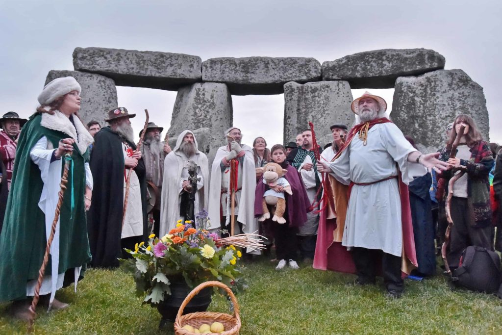 druids gather in the inner circle for the equinox at stonehenge