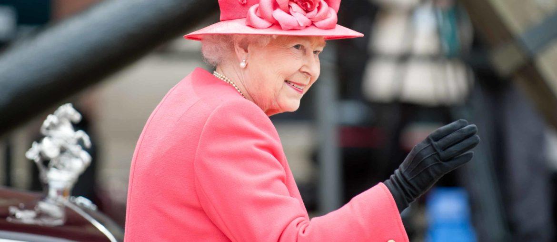 hrh queen elizabeth wearing pink coat and matching hat