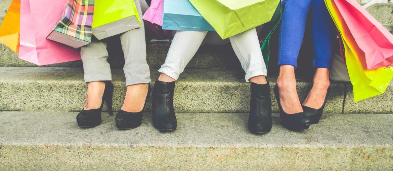 group of women carrying shopping bags