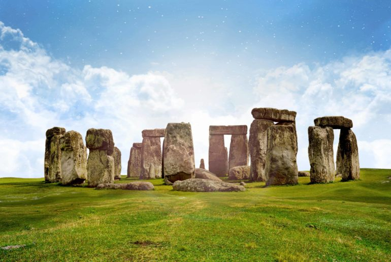 panoramic view of stonehenge on a clear day with blue skies