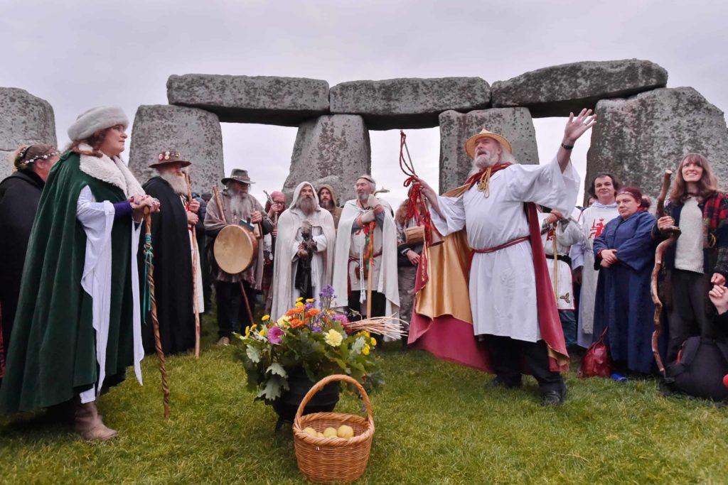 a group of druids celebrating at stonehenge