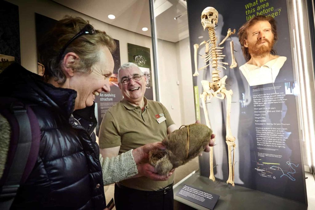 people looking at a display in the stonehenge exhibition centre