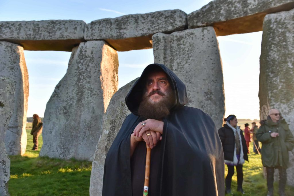 a man dressed up as a druid at stonehenge