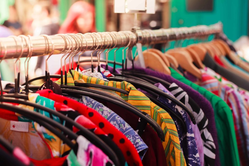 vintage clothing on a rail in a london market